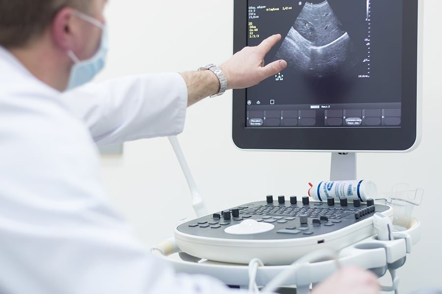 A doctor discussing an ultrasound with a patient
